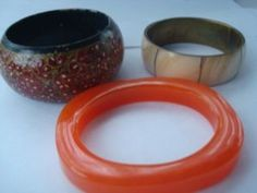This set is a bargain for the orangey-brown lucite bracelet alone.  If anyone is interested, I have a HUGE version of this bracelet available for sale in the JM swap thread.  Link below:  http://www.facebook.com/topic.php?uid=121801907861356&topic=917