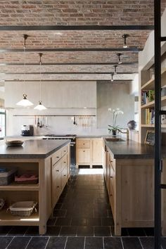 Renovated farmhouse in Belgium, referencing traditional materials with oak, slate and brick