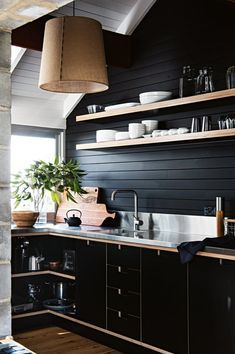 Black plywood kitchen cupboards and stainless steel benchtop give it a modern feel. The original cypress wood walls are painted with Porter's Paints Palm Beach Black. Custom made light shade from Paralume. Rustic Kitchen Cabinets, Painting Kitchen Cabinets, Farmhouse Kitchen Decor, Home Decor Kitchen, Kitchen Countertops, Country Kitchen, Kitchen Interior, New Kitchen, Kitchen Ideas
