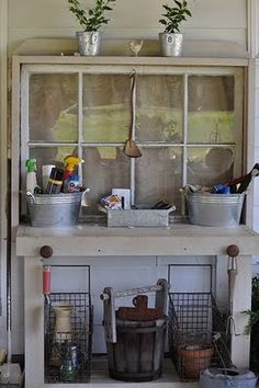 I love how they used an old window for the back of the potting bench