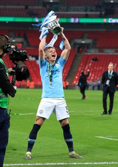 Oleksandr Zinchenko of Manchester City celebrates with the trophy. Ukraine Football, Manchester City Wallpaper, Zen, Wembley Stadium, Victorious, Chelsea, London England, Premier League, Celebrities