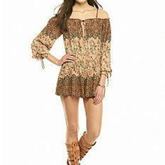 Free People romper Off the shoulder romper with elastic waist and split neckline. Perfect addition to your wardrobe! Three-quarter raglan sleeves, partially lined. Woven fabric. Rayon. Free People Shorts