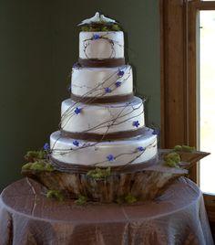 Adding a bit of sheen to a rustic wedding cake design.
