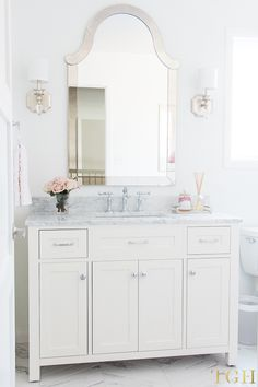 Simple design tips for all white bathrooms to help you with your next remodel. Five beginner design tips for white bathrooms. See more photos of this all white bathroom remodel! White Laundry Rooms, Laundry Room Bathroom, White Vanity Bathroom, White Rooms, Simple Bathroom, White Bathrooms, Bath Room, Bathroom Ideas, Bathroom Cabinets