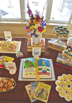 Storybook cake, book decor, and nursery rhyme foods for a storybook baby shower.