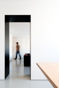 :: PROJECT :: DETAILS :: pass through detail @ master ensuite / dressing to bedroom + front foyer to kitchen ... lovely pass through detail in bold black to create dramatic passage ways between spaces. Apartment in Carcavelos by Hugo Proenca #project #detail