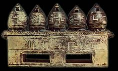 Geometric pyxis in the form of granaries. It was found in the burial of a wealthy Athenian woman to the northwest of the Areios Pagos. Mid-9th century BC.  Agora Museum, Athens P 27646. Hellenic Ministry of Culture/Archaeological Receipts Fund.  © Hellenic Ministry of Culture