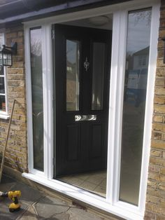 Stunning Ludlow Timber Composite Door finished in Anthracite Grey with twin side panels. Fitted by Timber Composite Doors #timbercompositedoors #solidor #solidorcompositedoors