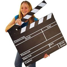 Cause a big scene and break into show biz with this giant clapboard. This 28 inch wide by 24 inch high clapboard is the power prop you need to get noticed. Features an erasable chalkboard surface and hinged clapper that really works. Great for writing family and office messages. Display in your TV viewing room, video store, movie theater or production facility. Height: 59.69cm (23.5 in.) Width: 72.39cm (28.5 in.) Material: Masonite board with wooden clappers