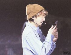 He is looking at the phone like a monkey. Cute monkey. Jungkook BTS