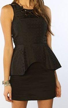 Kim wears a findersKEEPERS the Beyond Call Dress in Black on Kourtney & Kim Take Miami