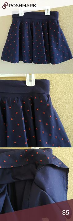 Gymboree Navy Blue Skirt w/ Red Hearts size 8 Adorable Gymboree Navy Blue Skirt with Red Hearts size 8. Such a cute skirt with a soft folded band waist for a comfy fit. It is fully lined as shown in the 3rd pic. Excellent condition worn once Gymboree Bottoms Skirts