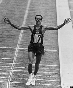 Abebe Bikila ~ In the 1960 Olympic games, Ethiopian marathoner Abebe Bikila wowed the sporting world when he clinched the gold medal, running the marathon in a record time of 2 hours, 15 minutes and 16 seconds. Bikila was the first Sub-Saharan African to win an Olympic gold medal -- and he achieve this tremendous feat barefoot.