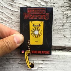 Stranger Things enamel pin - Joyce Byers' Phone by WeirdoWeapons on Etsy https://www.etsy.com/listing/472175172/stranger-things-enamel-pin-joyce-byers