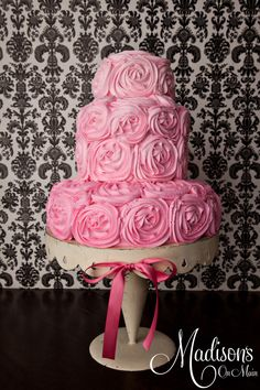 One of my all time favorite cakes I created.  I did this using the rosette method with three shades of pink buttercream.  The bride and I used her dress as inspiration for the cake....as it had large fabric roses on the skirt.