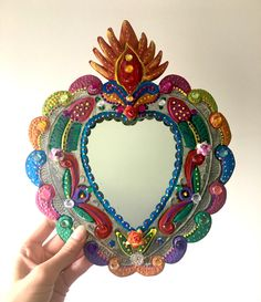 Sacred Heart tin metal mirror / Mexican folk art / bright colorful mixed media / geometric / flaming heart tin metal by TheVirginRose on Etsy https://www.etsy.com/listing/463286825/sacred-heart-tin-metal-mirror-mexican