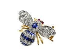 18ct White and Yellow Gold Small Sapphire diamond bee brooch.  http://www.luciecampbell.com/brooches/All/1188--2/  £2650  richard@luciecampbell.com  Lucie Campbell Jewellers Bond Street London  http://www.luciecampbell.com