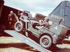 A jeep, equipped with a portable radio is loaded onto a C-47 for transport to France. England - 1944