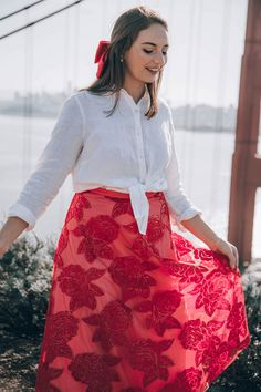 gorgeous red floral skirt from anthro. perfect for engagement shoots #engagementphoto