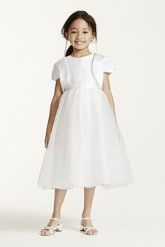 Adorable satin flower girl jacket provides just the right amount of coverage.  Features short cap sleeves.  Satin fabriclooks great with any of our styles.  Shown with Flower Girl style FG9309.  Available in White or Ivory.