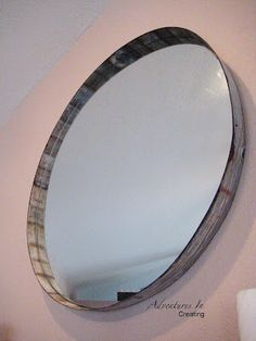 A mirror set in a 'rusty steel ring' from a whiskey barrel planter!  Wow!