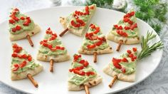 When it comes to Christmas appetizers, it doesn't get much easier than this. Make a forest of pita bread trees by topping pita wedges with store-bought guacamole. They can be made minutes before the party guests arrive.Pita Tree Appetizers - Creative Christmas Food Ideas