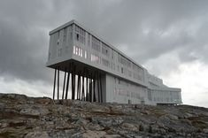 On the rugged coastal terrain of north Fogo Island, this luxe hotel in an ultra-modern x-shaped building is perched on stilts atop jagged rocks Fogo Island Inn, Newfoundland And Labrador, Island Tour, Island Girl, Summer Travel, The Good Place, Skyscraper, Tours, Adventure