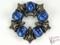 Cini Sterling and Sapphire Blue Glass cabochon brooch