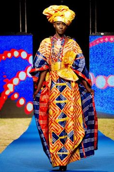 A model wears a creation by designer Alphadi of Niger during the final night of fashion shows at the 10th annual edition of Dakar Fashion Week été  2012 www.filystore.com