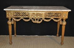 Beautiful Louis XVI Console, carved and gilt wood. 18th Century. Elegant carved cross bar with rosace style and laurel garland decor. For sale on Proantic by Hugo Mesureur. #console   #18thcentury