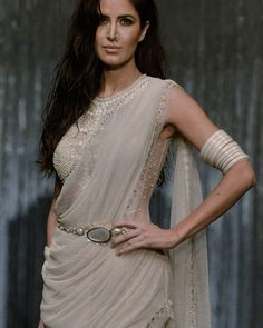 Katrina Kaif looked like a vision walking the ramp for Tarun Tahiliani over the weekend. Her sheer blouse was embellished with pearl beads and the look was completed with a kamar bandh & ivory bangles on her forearm. Bollywood Celebrities, Bollywood Fashion, Bollywood Actress, Bollywood Style, Tarun Tahiliani, Indian Dresses, Indian Outfits, Indian Clothes, Katrina Kaif Photo