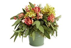 """13"""" Roses & Hydrangea in Bucket, Pink For a lovely, lifelike centerpiece that will never need tending, top your table or buffet with this freeze-dried arrangement of pink roses, seeded eucalyptus, green hydrangea, and pink larkspur inside a stylish tin.  From The Garden specializes in beautiful, modern designs of dried and preserved floral wreaths and arrangements.  Keep indoors out of direct sunlight and heating elements.  Size:  9"""" x 13""""."""