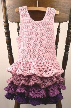 Crochet ruffle dress pattern  http://www.caron.com/projects/ss/ss_rows_ruffles_dress.html