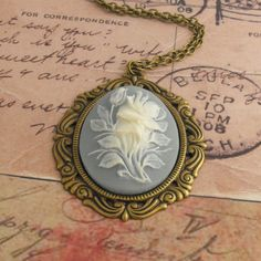 Blue Flower Cameo Necklace with Antique by vintagejewellerybox, £10.00