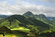 Another panorama of Flores Island, east coast, showing how steep the terrain is, and how high the crops are planted.  Some great hies here!  Stock Images