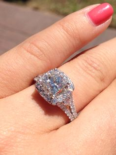 Stop telling her how much you love her, show her!  Princess cut diamond with halo. Available for purchase at Sissy's Log Cabin.  ***See a video of all angles of this ring on Facebook and Instagram*** Facebook.com/amberatsissys Instagram.com/amberatsissys
