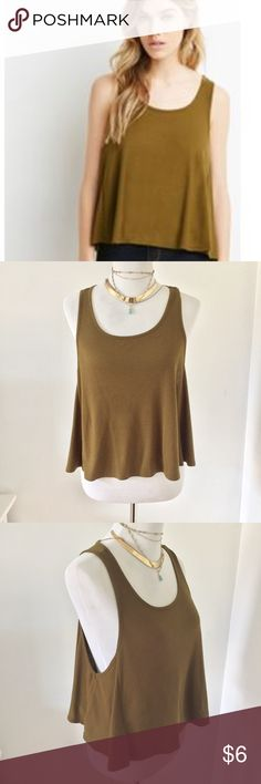 Olive Green Swing Ribbed Crop Top Forever 21 Olive Green Swing Ribbed Crop Top. Gently flared tank with ribbed knit ideal for layering.The perfect layering piece for the year-round style, this tank lends an effortlessly on-trend look to your favorite ensembles. Its trapeze silhouette and figure-friendly, twirl-worthy cut make it ultra chic and carefree for your laid-back days. In excellent gently used condition. No obvious visible signs of wear. Size M. Please feel free to ask any questions…