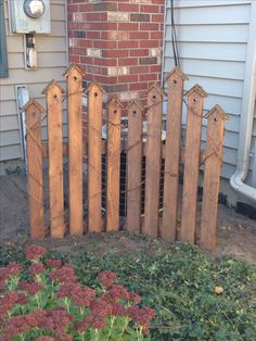 Bird house picket fence. Great way to hide an ugly air conditioner!