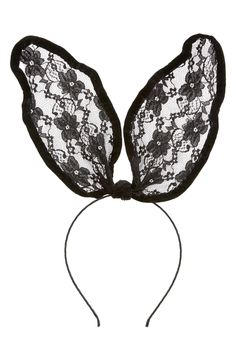 Adding a bit of playful drama to the hare-style this Halloween with this black lacy headband.
