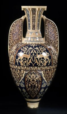 Alhambra Vase, by Théodore Deck, Paris, 1862. Earthenware, inlaid with colored clays & painted. This vase is a faithful replica of a celebrated lustreware jar recovered from the Alhambra, the palace fortress in Granada of the last Islamic dynasty to rule Spain. Tourists visited the Alhambra in the early 19th century, sparking a craze for 'Alhambra' design. #Theodore_Deck #Deck #pottery #art_pottery #lustreware #Spain #Alhambra