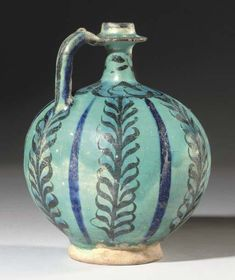 A KASHAN TURQUOISE AND BLACK POTTERY BOTTLE   CENTRAL IRAN, CIRCA 1200