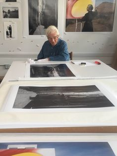 Tony Vaccaro in his studio signing his photos