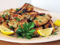 Lemon-Garlic Chicken Wings | I have been wanting to try to replicate this form Lebanese restaurant I go to. This recipe looks pretty close.