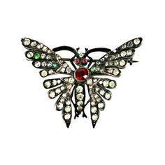 Preowned Victorian Paste Butterfly ($875) ❤ liked on Polyvore featuring jewelry, black, brooches, pre owned jewelry, preowned jewelry, butterfly jewelry, butterfly wing jewelry and ruby jewelry