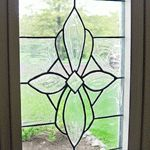 DIY - leaded glass window look-alike treatment using Gallery Glass products available at craft stores. Going to have to try this sometime.