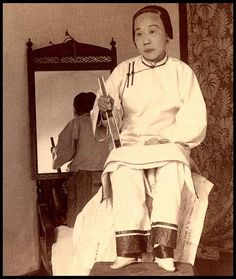 The above ca.1900 photo was made in a hotel in Shanghai. Her mother is off camera acting as chaperon. The girl did not want to expose her feet, but stereo-photographer JAMES RICALTON offered her four silver dollars if she said OK.