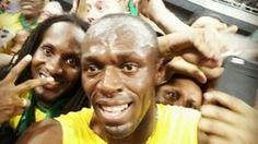 Selfie com amigo na multidão eterniza tri (Usain Bolt)