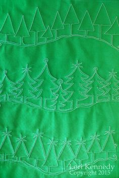 Evergreen-A Free Motion Quilt.  What a wonderful tutorial for the Holidays!  This concept would be great for landscape quilts as well.