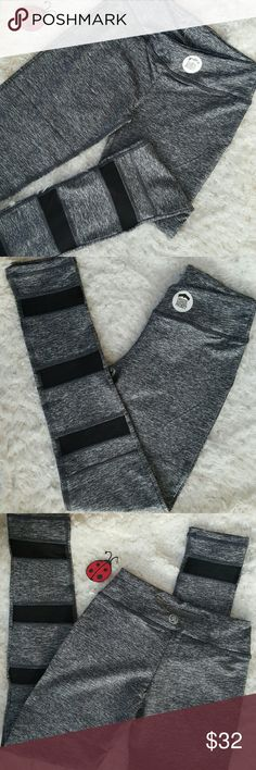 Heather black Mesh yoga workout leggings Awesome NEW heather gray with black mesh detail workout leggings in a size medium, with four way stretch, wicking, and flat seems for extra comfort.  Perfect for the gym, yoga, running , weight lifting.  Also available in white and yellow. Pants Leggings
