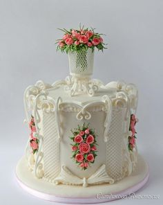 Cake with a bouquet of roses in an openwork vase by Anastasia